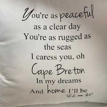 A pillow with a Rita MacNeil quote on it, from Rita's Tea Room, Sydney, NS